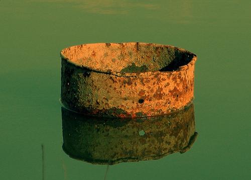 Metal drum in river
