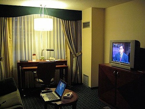 hotel room with old television and laptop