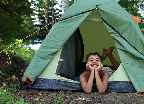 Kid inside his camping tent