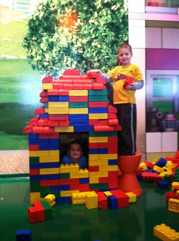 2 boys building Lego house